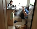 Stuck in the rain at Lake Erie. The family has taken refuge in the camper....